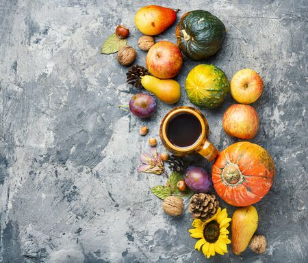 Autumn composing with pumpkin, fruit and fall leaves.Fall season