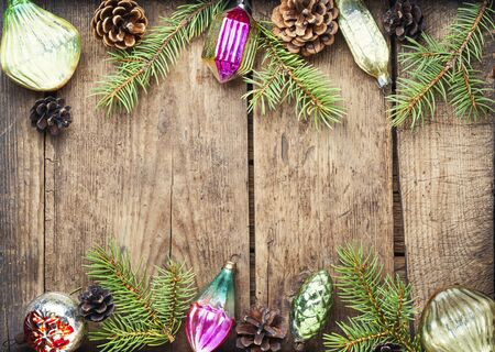 Christmas background with fir and decor.Winter composition on wooden background 写真素材