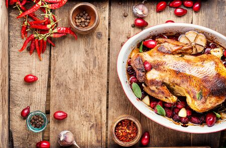 Baked chicken with dogwood.Roast chicken in berry sauce.Space for text