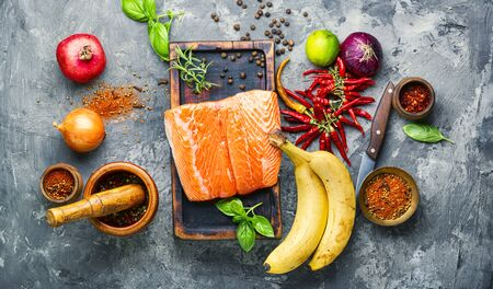 Fresh raw salmon fillet with cooking ingredients.Seafood