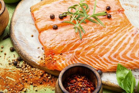 Fresh fish.Raw salmon fillet with cooking ingredients
