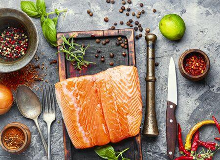 Fresh raw salmon fillet with cooking ingredients.Fresh fish Zdjęcie Seryjne
