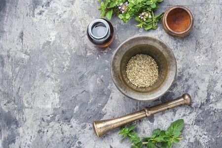 Oregano or marjoram leaves in mortar.Bunch healing herbs.Flat lay