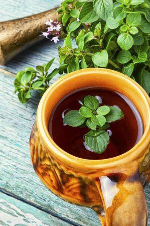 Medicinal tea from marjoram leaves.Herbal tea with oregano.