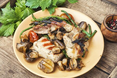Grilled juicy steak with mushrooms on a plate