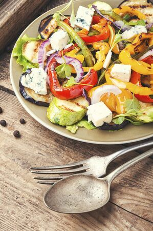 Grilled salad.Vegetable autumn salad with grilled vegetables and cheese.