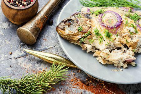 Baked fish at the Christmas table.Holiday food.Baked crucian.Fish food. 写真素材