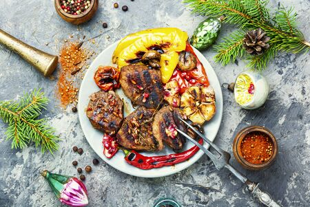 Grilled veal with vegetables.Christmas food.Beef in pomegranate sauce.Holiday food Stock Photo