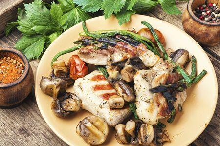 Grilled juicy steak with mushrooms on plate.Meat food 写真素材