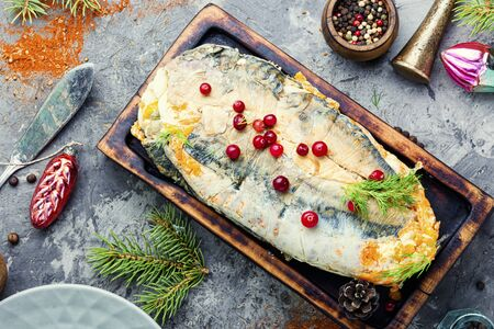 Fish roll.Fish stuffed with vegetables.Banquet dish or Christmas food 写真素材