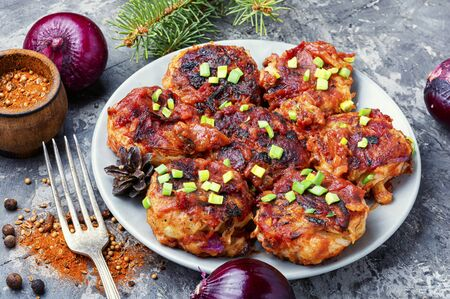 Vegetarian red onion cutlets on a plate.Vegetable cutlets