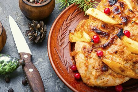 Grilled chicken breast with mango.Christmas baked chicken 写真素材