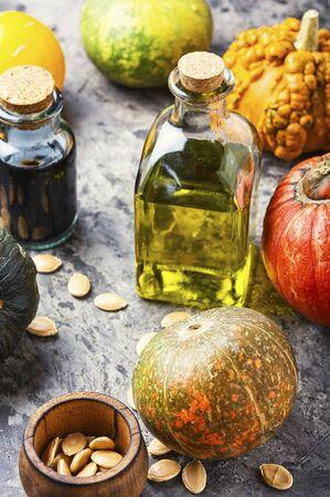 Pumpkin and healthy pumpkin seed oil.Autumn food 写真素材