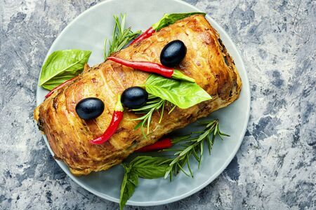 Traditional meat terrine stuffed with mushrooms to the festive table.Christmas dishes.