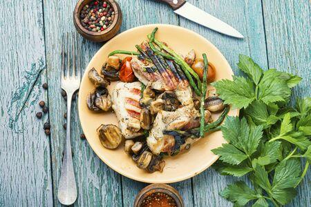 Grilled juicy steak with mushrooms on plate 写真素材