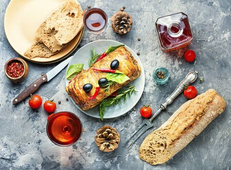 Appetizing meat terrine and wine for Christmas.Holiday food
