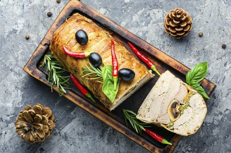 Appetizing meat terrine for Christmas on the kitchen board.Holiday food