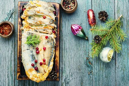 Fish roll.Fish stuffed with vegetables.Banquet dish or Christmas food Imagens