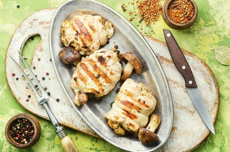 Chicken rolls stuffed with wild mushrooms on metal stylish dish
