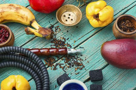 Hookah tobacco with the taste of mango, pomegranate and quince.Tobacco with the aroma of tropical fruits.Oriental smoking shisha