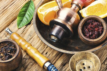Hookah tobacco with the taste of orange.Tobacco with the aroma of tropical fruits.Turkish smoking kalian