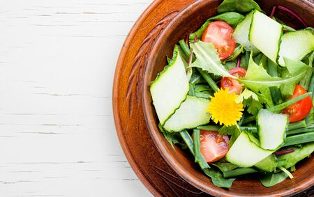 Summer salad with vegetables, herbs and dandelions. Spring diet