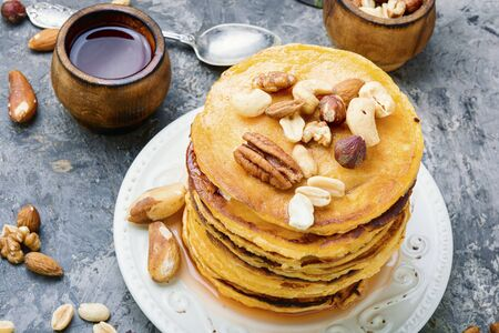 Appetizing pancakes with nuts and maple syrup.Pancake, breakfast 写真素材