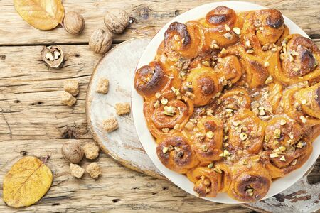 Pumpkin buns with nuts and brown sugar.