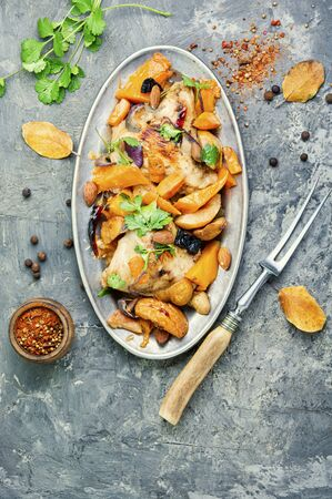 Baked meat with pumpkin and quince.Chicken stew with pumpkin. Stok Fotoğraf - 134448039