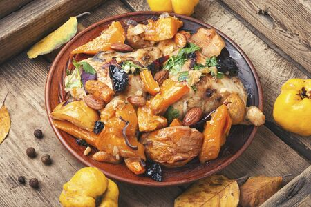 Chicken, pumpkin and vegetable meat stew.Autumn food. Stok Fotoğraf - 134448046