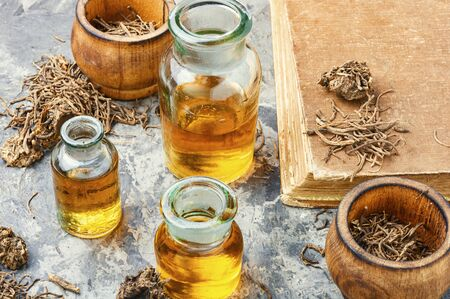 Medicinal tincture from the roots and rhizomes of valerian.Alternative medicine Stok Fotoğraf