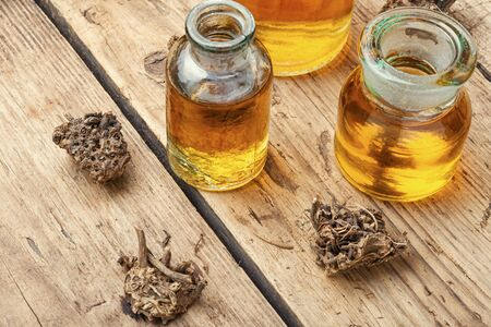 Medicinal tincture from the roots and rhizomes of valerian.Herbal medicine Stok Fotoğraf - 134448073
