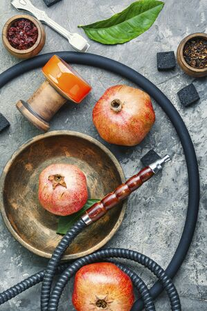 Turkish smoking hookah.Hookah with tobacco with pomegranate flavor.Hookah concept. Stok Fotoğraf - 134448077