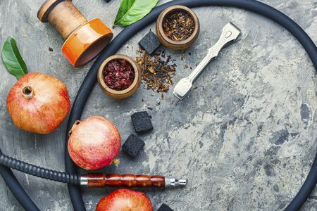Oriental smoking hookah.Pomegranate flavor hookah.Fruit tobacco shisha