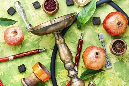Arabic smoking hookah.Pomegranate flavor hookah.Fruit tobacco shisha.Trendy hookah