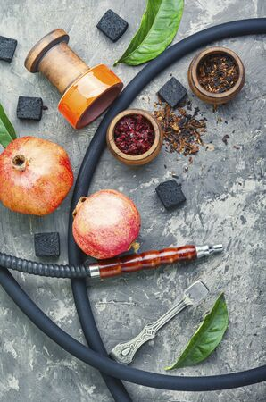 Turkish smoking hookah.Hookah with tobacco with pomegranate flavor.Hookah concept. Stok Fotoğraf