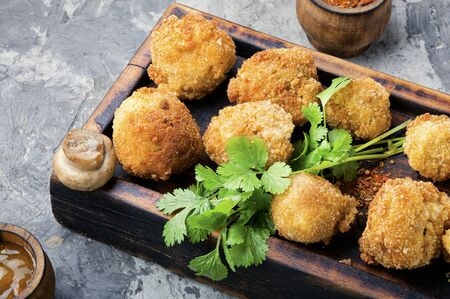 Breaded mushrooms or deep-fried mushrooms on cutting board