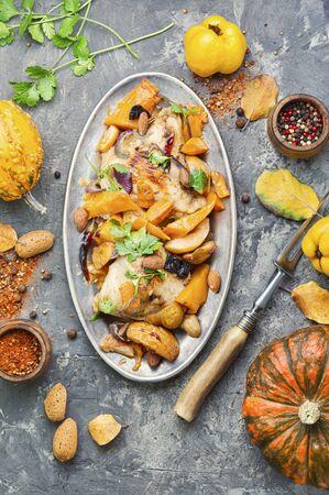 Chicken stew with pumpkin and quince.Autumn menu. Standard-Bild - 134957619