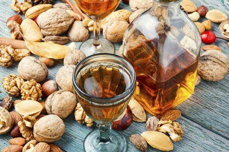 Aromatic alcohol from nuts.Nut liquor.Tincture on nuts.Italian liquor Stock Photo