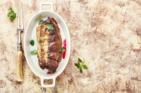 Roasted pork with cherry filling.Baked pork in a baking dish