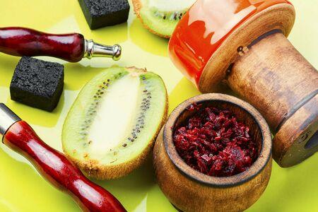 Arabic smoking hookah with taste of kiwi.Fruit shisha tobacco. Tobacco with taste of kiwi.Oriental tobacco hooka