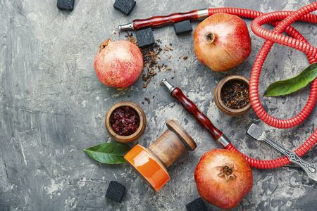 Turkish smoking hookah.Hookah with tobacco with pomegranate flavor.Hookah concept. Stock Photo