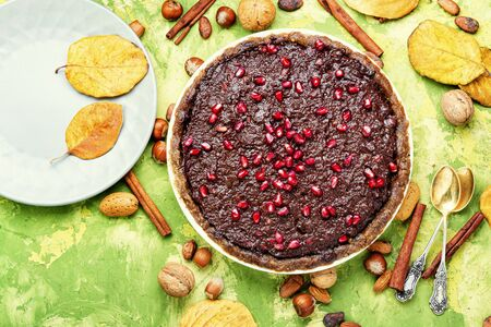 Delicious chocolate cake with pomegranate and nut.Chocolate brownie cake Stock Photo
