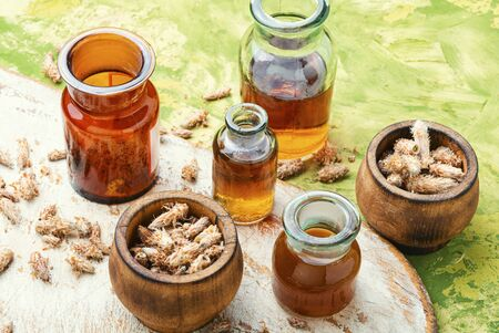 Healing decoction from pine kidneys.Dried pine buds.Medicinal tincture for colds.