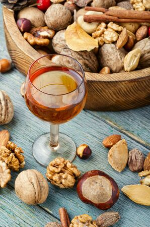 Shot glass with aromatic alcohol from nuts.Nut liquor.Tincture on nuts.Nut flavoring