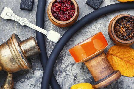 Oriental smoking shisha.Hookah bowl and tobacco.Details of Turkish nargile.Kalian tobacco Stock Photo