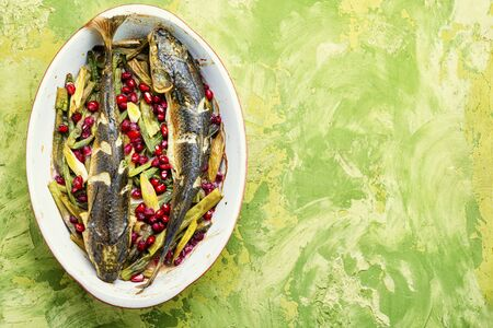 Pelengas baked with vegetables and pomegranate.Copy space,space for text Stock Photo
