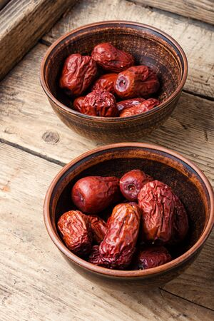 Bowl of dried unabi fruit or jujube.Medicinal and edible plant