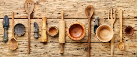 Concept of wooden rustic kitchenware utensils set on old background