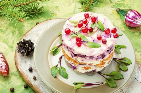 Seafood salad with herring and vegetables.Traditional New Year salad with herring